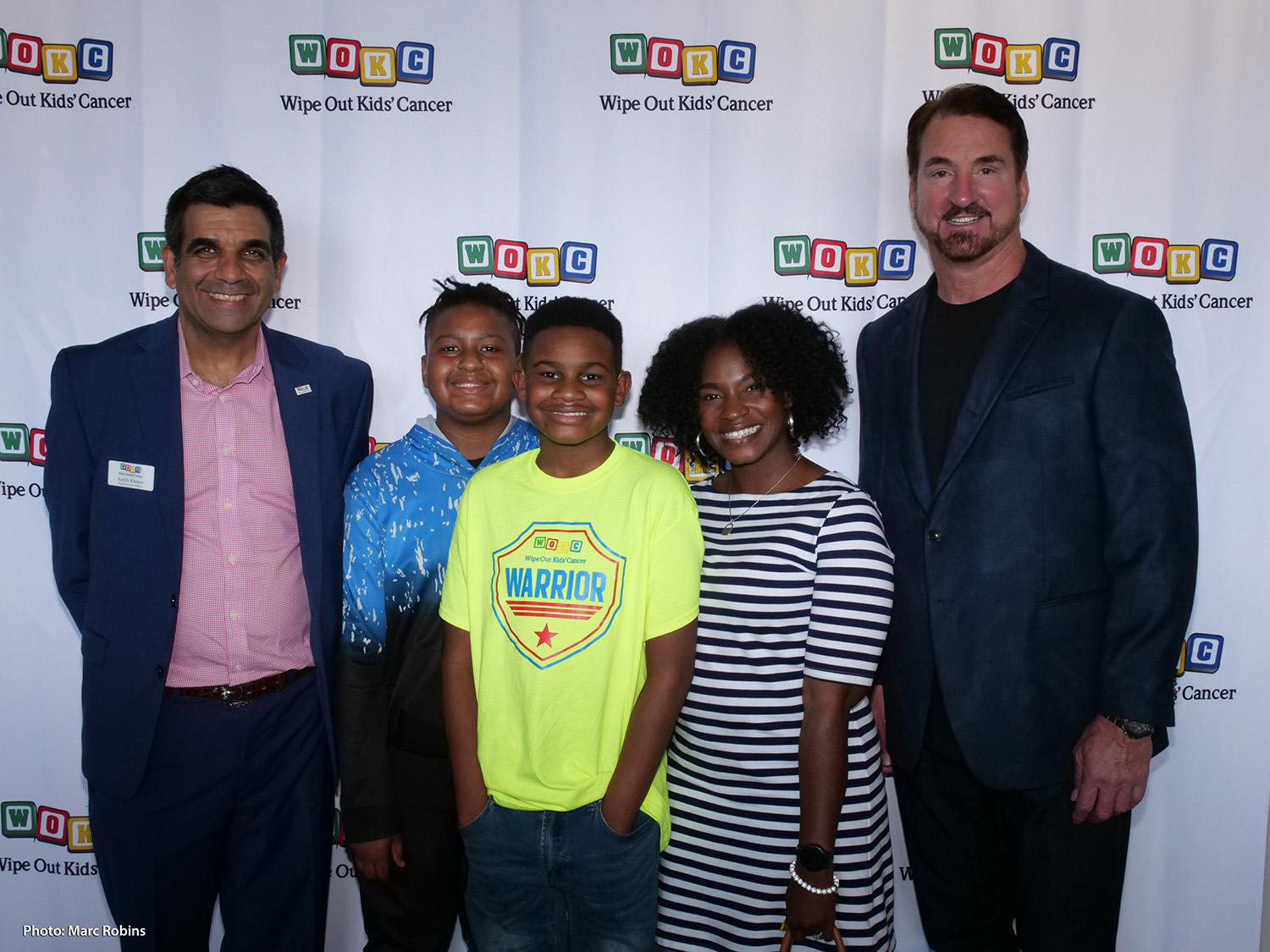 Former Cowboys QB Babe Laufenberg Surprises Wipe Out Kids' Cancer Warriors & Their Families at Viewing Party for WOKC Buddy Bag Bash